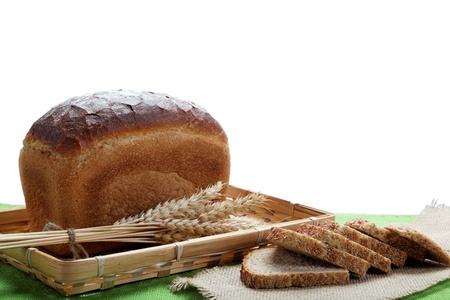 Fresh bread with ears of wheat on the canvas. Stock Photo - 16002550