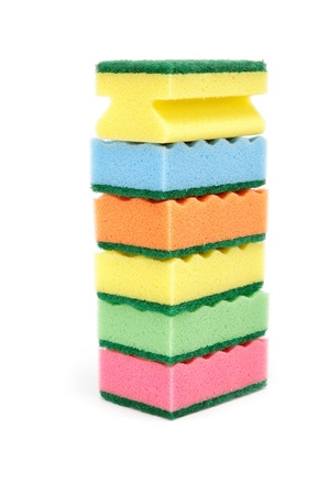 Stack of cleaning sponges on a white background. Banco de Imagens