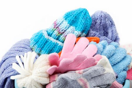Winter accessory collection. Hat, scarf and mittens, isolated on white background. photo