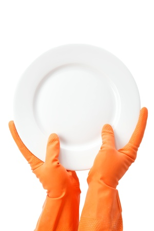 rubber gloves: Hands in rubber gloves holding the plate on a white background.