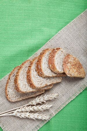 Fresh bread with ears of wheat on the canvas. Stock Photo - 16426632