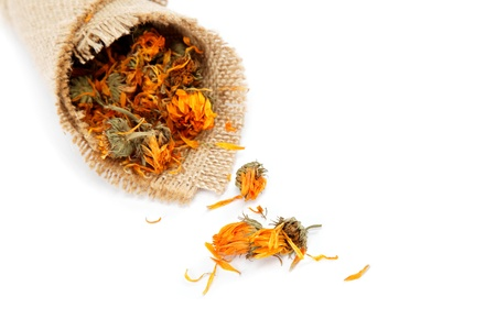 Herbs. Dried calendula or pot marigold flowers isolated on white background. Stock Photo - 16780277