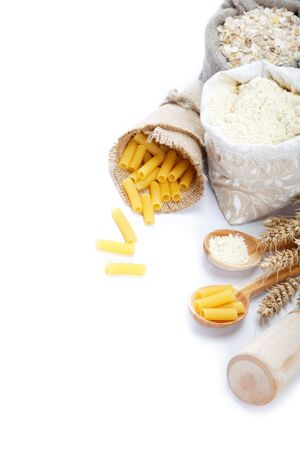 yellow flour: Flour in a canvas bag and ear on white background.