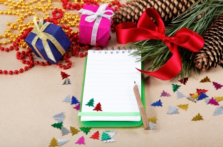 Christmas decorations, gifts and a notebook for congratulations.  Stock Photo - 16780306