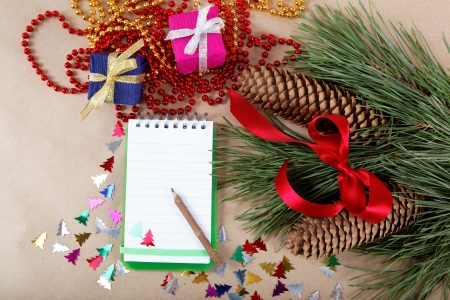 Christmas decorations, gifts and a notebook for congratulations. Stock Photo - 16858711