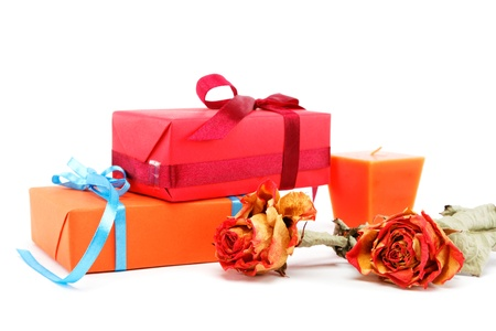 Gifts pack with a roses and the candle isolated on a white background. Stock Photo - 17512556