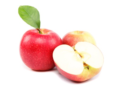 Fresh red apples with a slice isolated on white background. photo