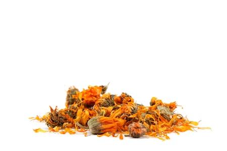 Herbs. Dried calendula or pot marigold flowers isolated on white background. Standard-Bild