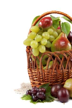 Fresh fruits in a basket on white background. Set of different. Stock Photo - 17943917