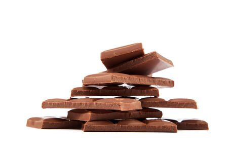 Stack of chocolate pieces on a white background. Stock Photo - 18140103