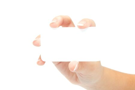Female hand with a blank card isolated on white background. photo
