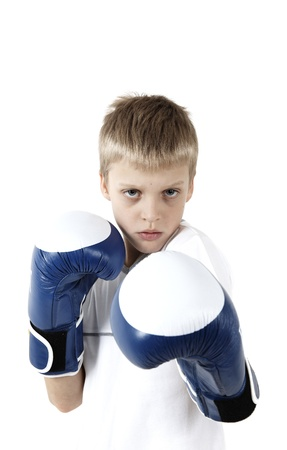 ggression: The boy in boxing gloves isolated on a white background