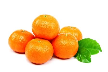 Fresh fruits mandarin oranges on a white background. Stock Photo