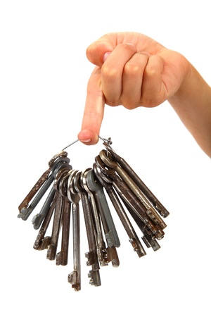 Bunch of old keys in hand isolated on a white background. photo