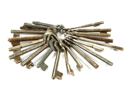 Bunch of old keys isolated on a white background. photo