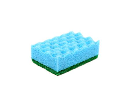 Cleaning sponge on a white . Фото со стока