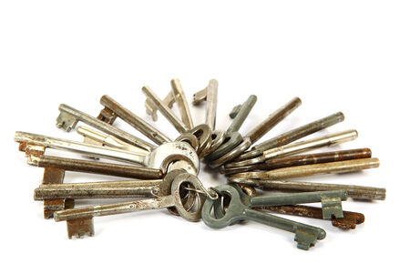 Bunch of old keys isolated on a white . photo