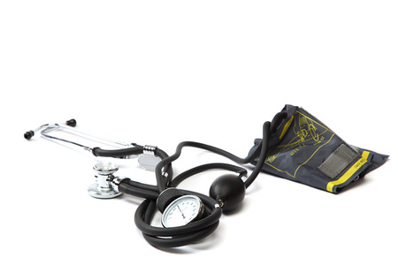 Medical stethoscope and sphygmomanometer isolated on a white . Stock Photo - 24090998