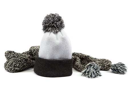 Cold winter clothing - hat or cap, scarf, isolated on a white .