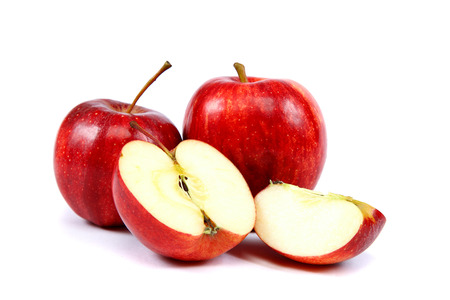 Fresh red apples with a slice isolated on white . Stock Photo