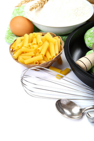 Supplies and ingredients for baking or making pasta , isolated on white background  photo