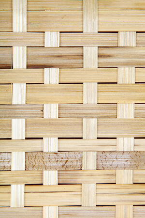 Wooden grid, the background of woven wood. Bamboo wood texture. photo