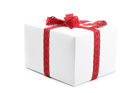 ribbon bow: White gift box with red ribbon bow, isolated on white background. Stock Photo