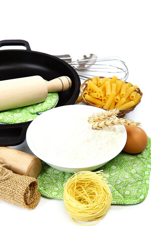 Supplies and ingredients for baking or making pasta, isolated on white background. photo