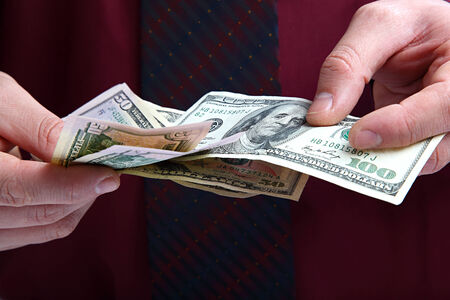 Banknotes in the hands of a businessman. photo