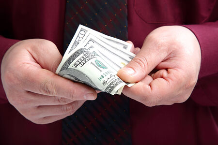Banknotes in the hands of a businessman. Stock Photo
