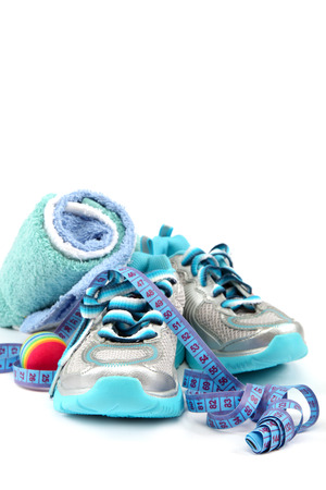 Sport shoes, equipment and measuring tape on a white background. photo
