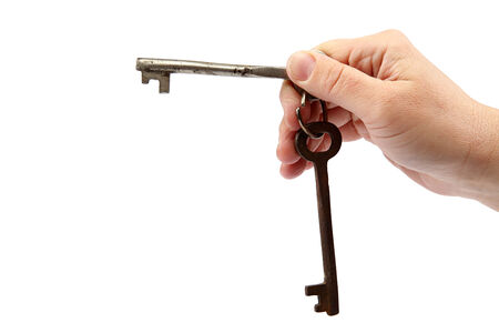 Old keys in hand isolated on a white background. photo