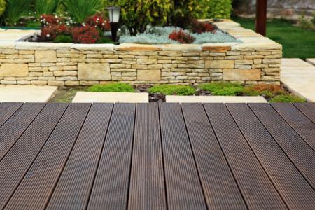 Wood floor over background beautiful modern decorative garden design. Stock Photo