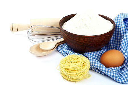 beater: Supplies and ingredients for baking or making pasta , isolated on white background.