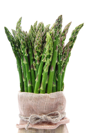Fresh green asparagus isolated on a white background.