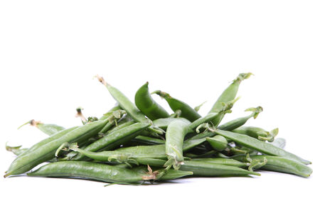 Green pea pods isolated on white background. photo