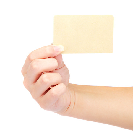 cash slips: Beautiful female hand holding a gold blank card isolated on a white background. Stock Photo