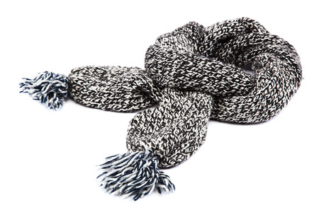 Cold winter clothing. Wool scarf, isolated on white background. photo