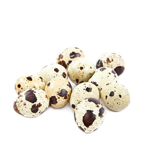 Quail eggs isolated on white background. photo