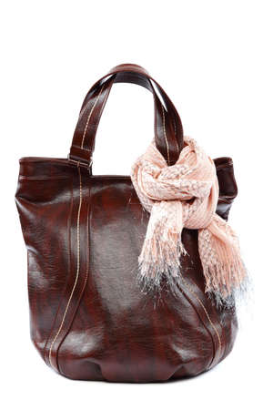 Modern fashionable female bag and scarf with tassels isolated on white background. photo