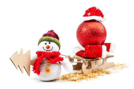 christmas sleigh: Snowman with sled, Christmas tree and New Years ball isolated on a white background. Stock Photo