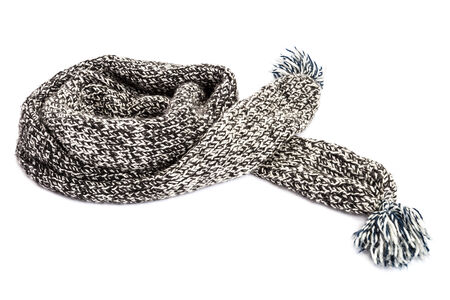 Striped knitted woollen scarf isolated on white background.