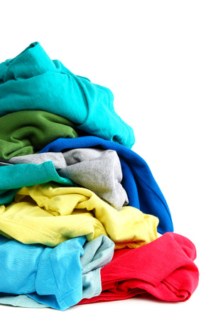 Pile of clothes washing isolated on white background. Standard-Bild