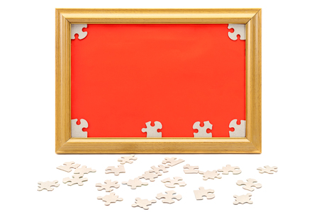 disharmony: Image in the frame and scattered puzzle isolated on white background.
