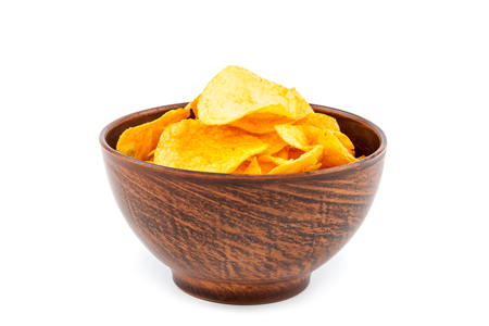 consuming: Potato chips in a wooden bowl isolated on white background.