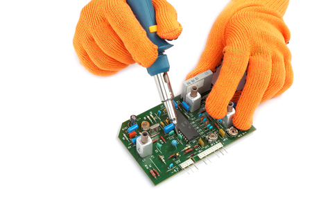 rosin: Soldering iron in hand and electric board isolated on a white background.