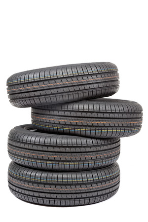 pneumatic tyres: Car tires isolated on white background.