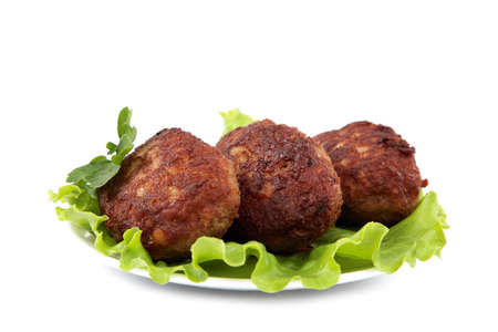 Meat patties with fresh lettuce isolated on a white background. photo
