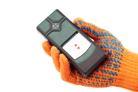 Modern laser measuring level in hand with glove isolated on white background. photo