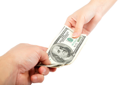 money in hand: Transferring of money from hand to hand is isolated on a white background.